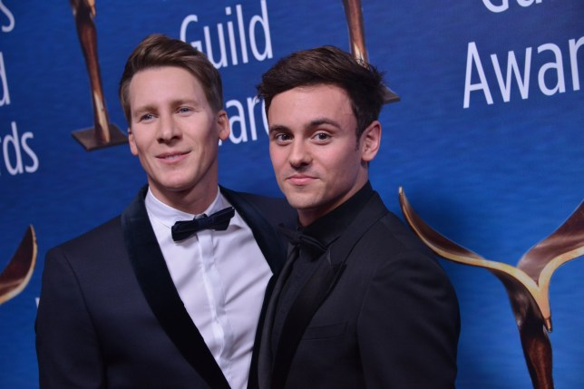 Dustin Lance Black and Tom Daley arrives the 2018 Writers Guild Awards L.A. Ceremony at the Beverly Hilton in Beverly Hills, CA on February 11, 2018. (Photo By Sthanlee B. Mirador/Sipa USA)