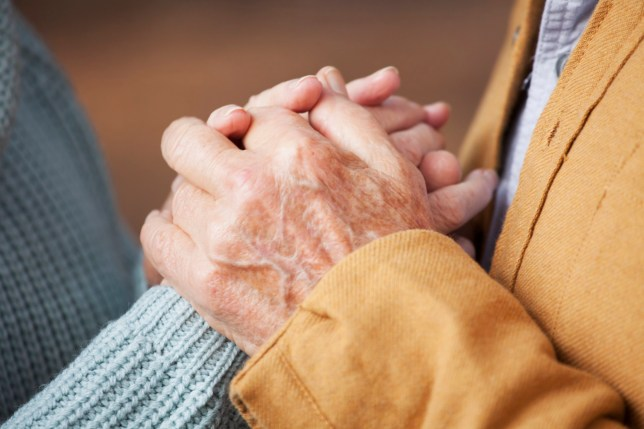 Close up of older couple holding hands