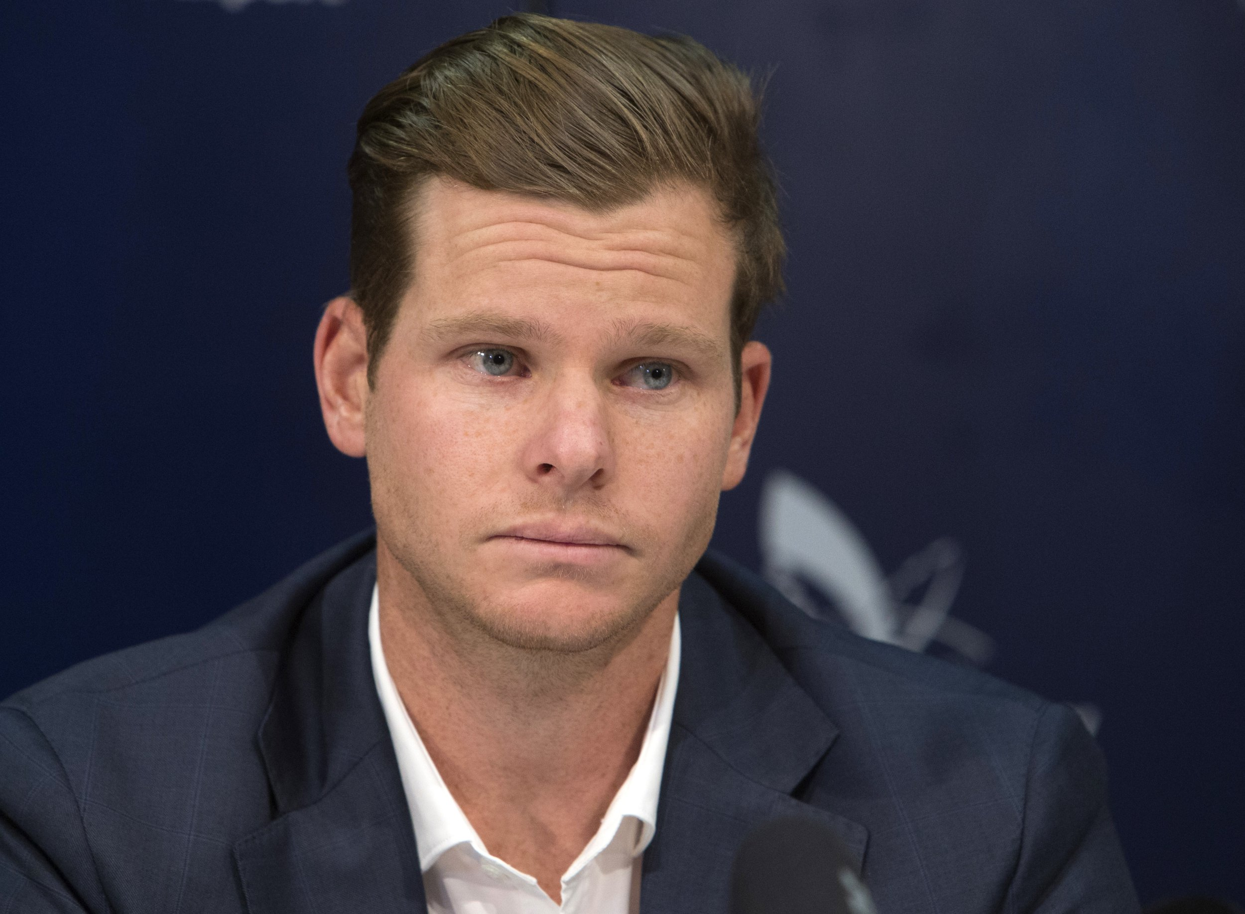 Former Australian cricket captain Steve Smith speaks to the media in Sydney, Thursday, March 29, 2018, after being sent home from South Africa following a ball tampering scandal. Smith and vice-captain David Warner were banned for 12 months while young batsman Cameron Bancroft received 9 months after an investigation into the Australian cricket team's cheating scandal identified Warner as the instigator of the ball tampering plan that unraveled in South Africa. (AP Photo/Steve Christo)