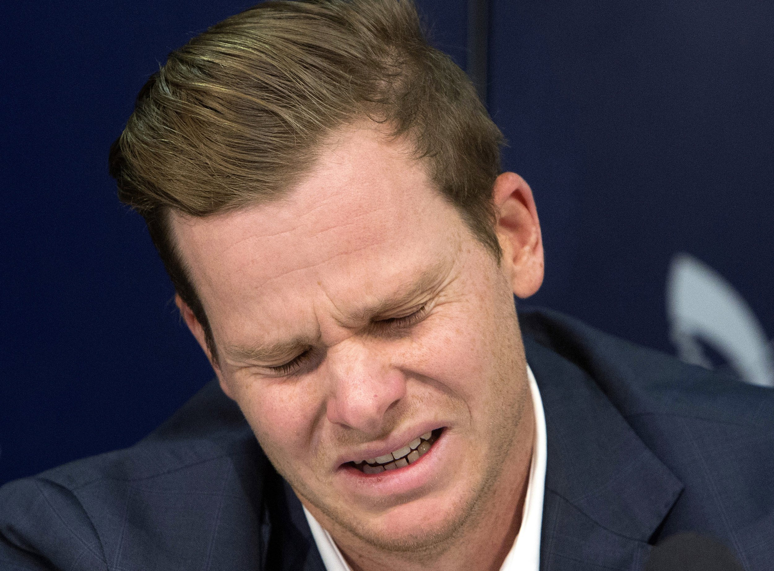 Former Australian cricket captain Steve Smith grimaces as he speaks to the media in Sydney, Thursday, March 29, 2018, after being sent home from South Africa following a ball tampering scandal. Smith and vice-captain David Warner were banned for 12 months while young batsman Cameron Bancroft received 9 months after an investigation into the Australian cricket team's cheating scandal identified Warner as the instigator of the ball tampering plan that unraveled in South Africa. (AP Photo/Steve Christo)