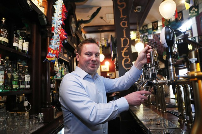 Brian Conlon, owner of Slattery's Bar on Capel street in Dublin, pulls a pint as legislation was passed earlier this year to allow pubs to serve alcohol. PRESS ASSOCIATION Photo. Picture date: Friday March 30, 2018. See PA story IRISH Pubs. Photo credit should read: Brian Lawless/PA Wire