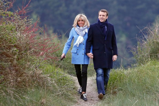 LE TOUQUET-PARIS-PLAGE, FRANCE - APRIL 22: Head of the political movement En Marche! (Onwards!) and candidate for the 2017 presidential election, Emmanuel Macron and his wife Brigitte Trogneux pose for a photograph on April 22, 2017 in Le Touquet, France. Macron is candidate for the France's 2017 presidential elections and polls predict his presence in the second round of this election. (Photo by Chesnot/Getty Images)