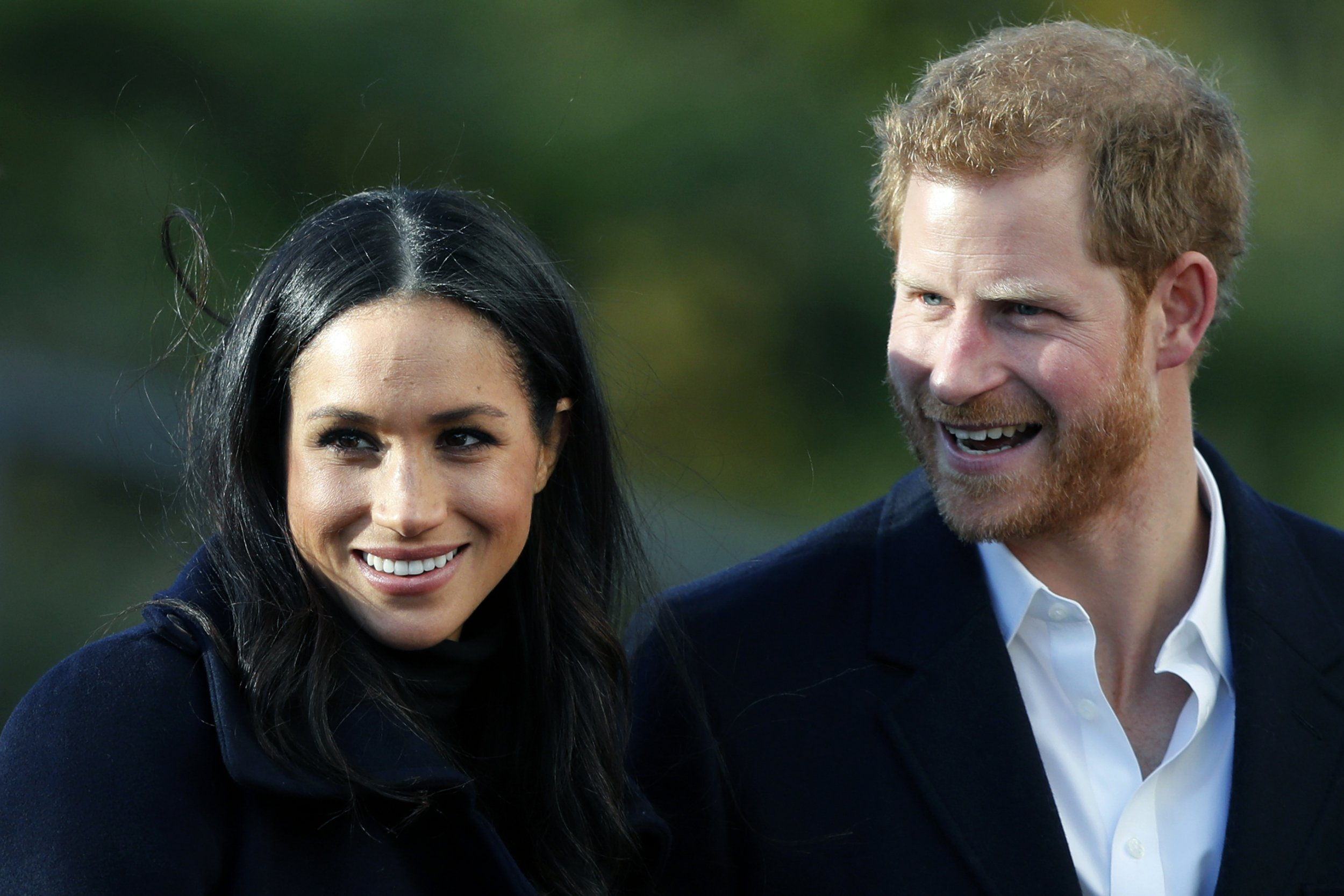 "FILE - In this file photo dated Friday, Dec. 1, 2017, Britain's Prince Harry and his fiancee Meghan Markle, in Nottingham, England. The Metropolitan Police force said ""a package containing a substance"" was delivered to St. James's Palace on Feb. 12, sent to Prince Harry and his fiancee Meghan Markle, and is now being investigated as a racist hate crime, Scotland Yard said Thursday Feb. 22, 2018. (AP Photo/Frank Augstein, FILE)"