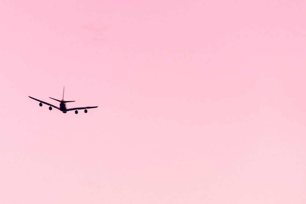 Commercial jet in flight at sunset