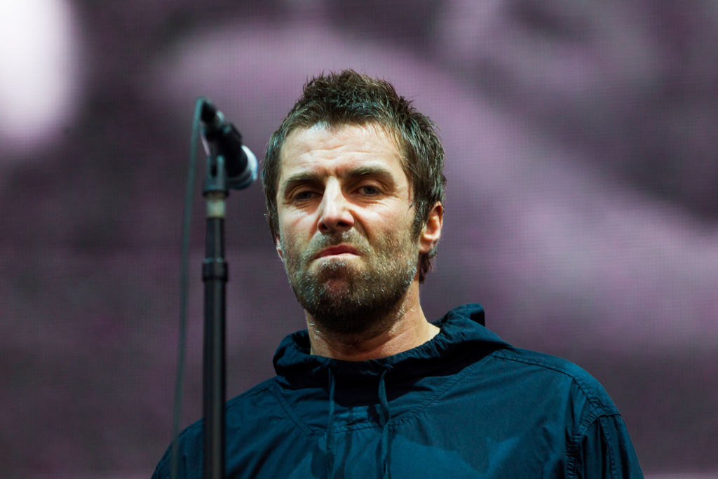 Liam Gallagher on stage with a microphone.
