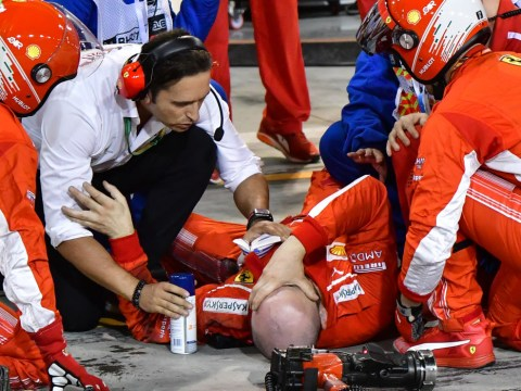 Sickening moment Kimi Raikkonen runs over own mechanic as Sebastian Vettel wins Bahrain GP