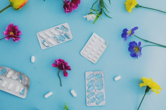 Allergy tablets and pills and flowers