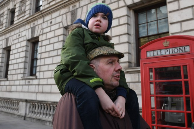 Six-year-old Alfie Dingley is carried by his father Drew Dingley along Whitehall in London before handing in a petition to Number 10 Downing Street asking for Alfie to be given medicinal cannabis to treat his epilepsy. PRESS ASSOCIATION Photo. Picture date: Tuesday March 20, 2018. Alfie suffers from a rare condition and can have up to 150 potentially life-threatening seizures a month. See PA story HEALTH Cannabis. Photo credit should read: Stefan Rousseau/PA Wire