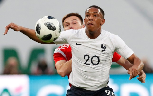 epa06632478 Vladimir Granat (L) of Russia in action against Anthony Martial (R) of France during the international friendly soccer match between Russia and France at the Zenit Arena in St. Petersburg, Russia, 27 March 2018. EPA/ANATOLY MALTSEV