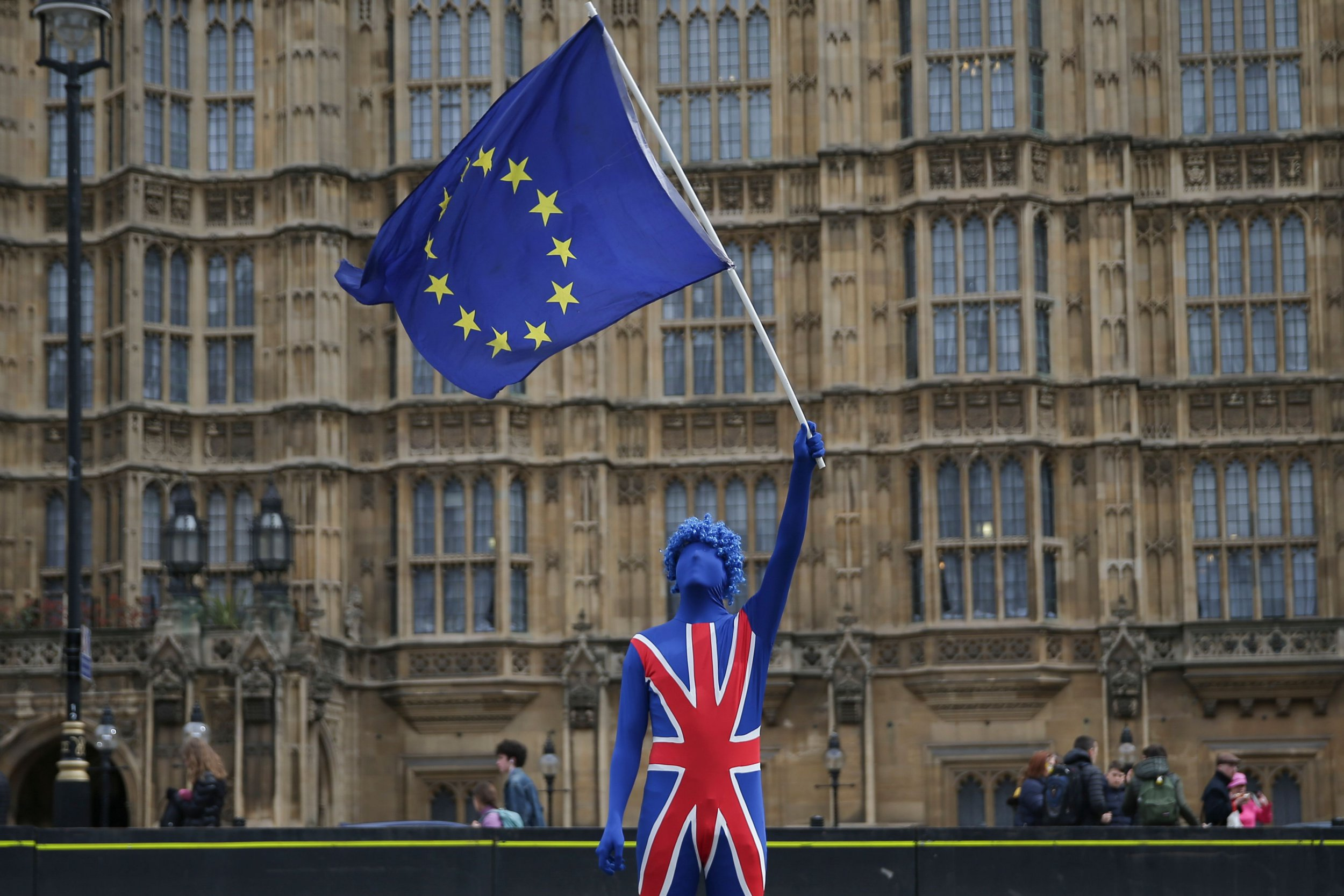 A anti-Brexit demonstrator dressed in a Union Flag suit and waving an EU flag stands on the road outside the Houses of Parliament in central London on March 29, 2018. The one-year countdown to Britain's exit from the European Union began on March 29, 2018 with Prime Minister Theresa May touring the UK shore up support for the government's Brexit strategy. / AFP PHOTO / Daniel LEAL-OLIVASDANIEL LEAL-OLIVAS/AFP/Getty Images
