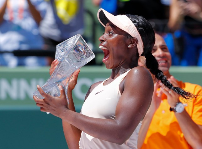 epaselect epa06639462 Sloane Stephens of the US reacts with the Butch Buchholz Trophy after defeating Jelena Ostapenko of Latvia during the women's final round round match at the Miami Open tennis tournament on Key Biscayne, Miami, Florida, USA, 31 March 2018. EPA/ERIK S. LESSER