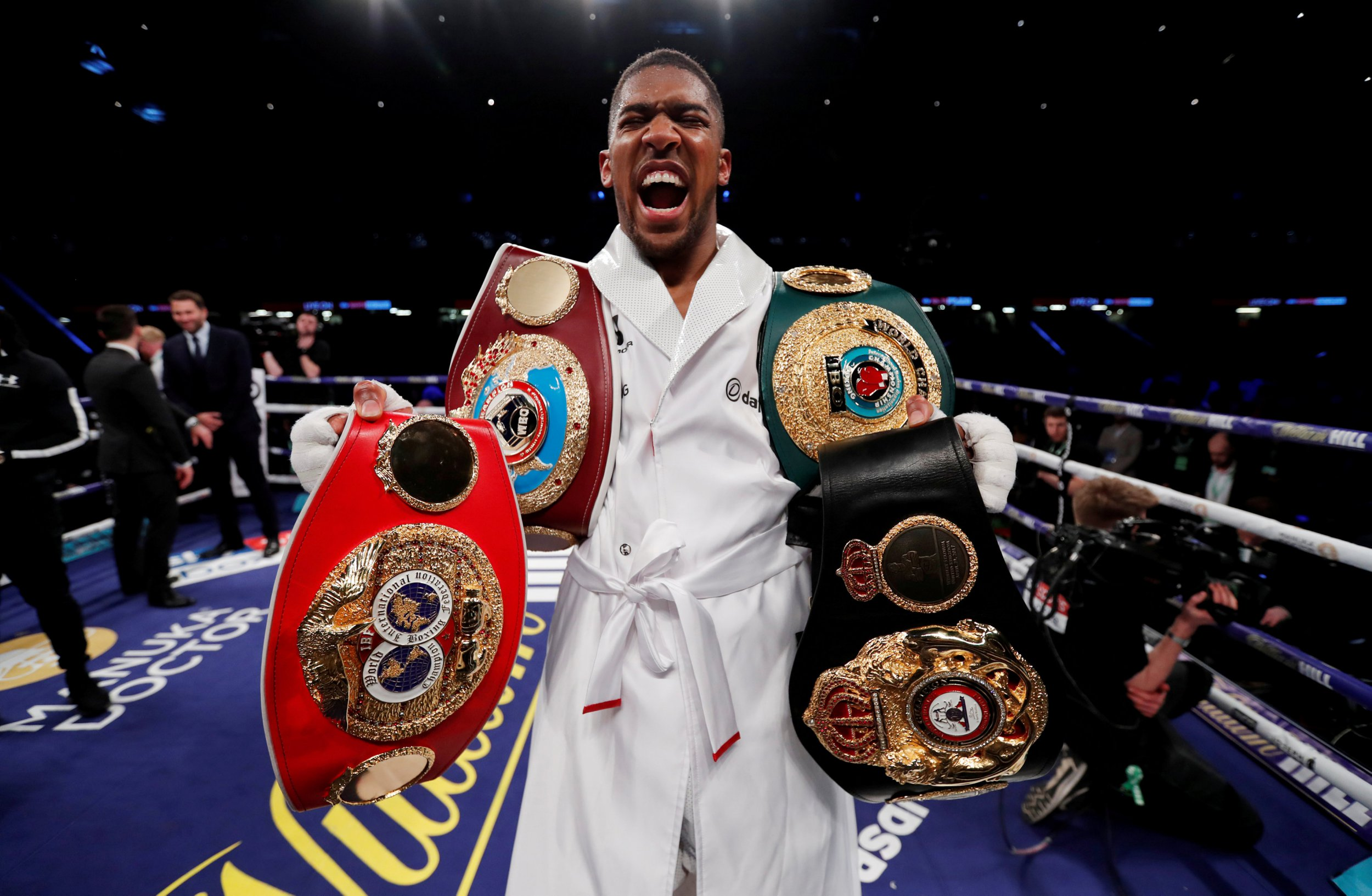 Boxing - Anthony Joshua vs Joseph Parker - World Heavyweight Title Unification Fight - Principality Stadium, Cardiff, Britain - March 31, 2018 Anthony Joshua celebrates with the belts after winning the fight Action Images via Reuters/Andrew Couldridge TPX IMAGES OF THE DAY