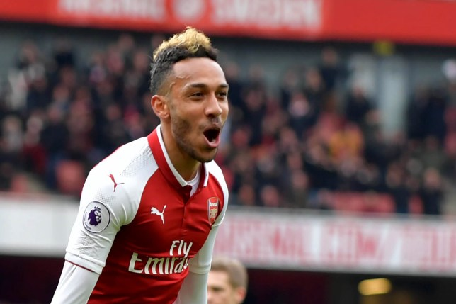 Arsenal's Gabonese striker Pierre-Emerick Aubameyang celebrates scoring the team's second goal during the English Premier League football match between Arsenal and Stoke City at the Emirates Stadium in London on April 1, 2018. / AFP PHOTO / Oliver GREENWOOD / RESTRICTED TO EDITORIAL USE. No use with unauthorized audio, video, data, fixture lists, club/league logos or 'live' services. Online in-match use limited to 75 images, no video emulation. No use in betting, games or single club/league/player publications. / OLIVER GREENWOOD/AFP/Getty Images