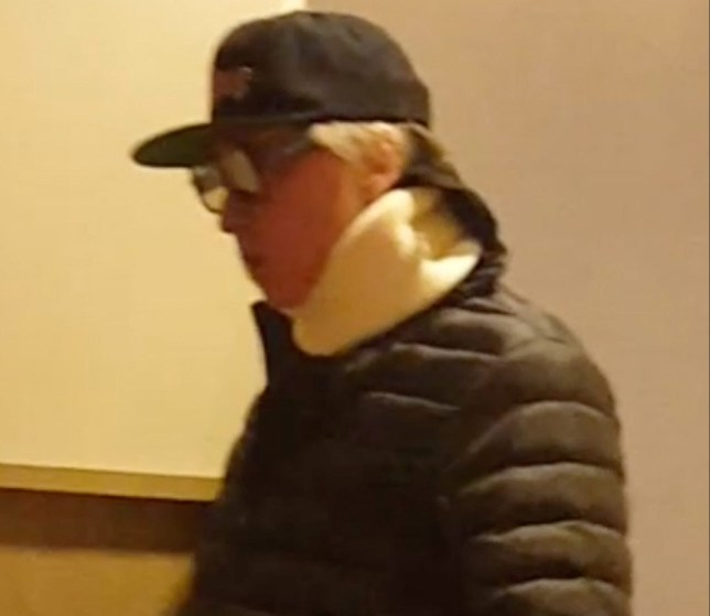 """Los Angeles, CA - *EXCLUSIVE* - Actor Val Kilmer is seen at the movie theater this evening to watch """"Pacific Rim Rising"""" and tries to go incognito with dark shades and trucker worn low and a neck brace. Val wore a big puffy parka jacket with sweats carrying a tote and appeared to be a little lost trying to find his theater to finish the movie. Upon walking out after the movie, Val opted to try to blend into the crowd to hopefully go unnoticed. The """"Top Gun'' star has been battling throat cancer for two years and has been spotted wearing what appeared to be a tracheostomy tube in 2015. *SHOT ON 03/28/2018* Pictured: Val Kilmer BACKGRID USA 3 APRIL 2018 BYLINE MUST READ: Sandy / BACKGRID USA: +1 310 798 9111 / usasales@backgrid.com UK: +44 208 344 2007 / uksales@backgrid.com *UK Clients - Pictures Containing Children Please Pixelate Face Prior To Publication*"""