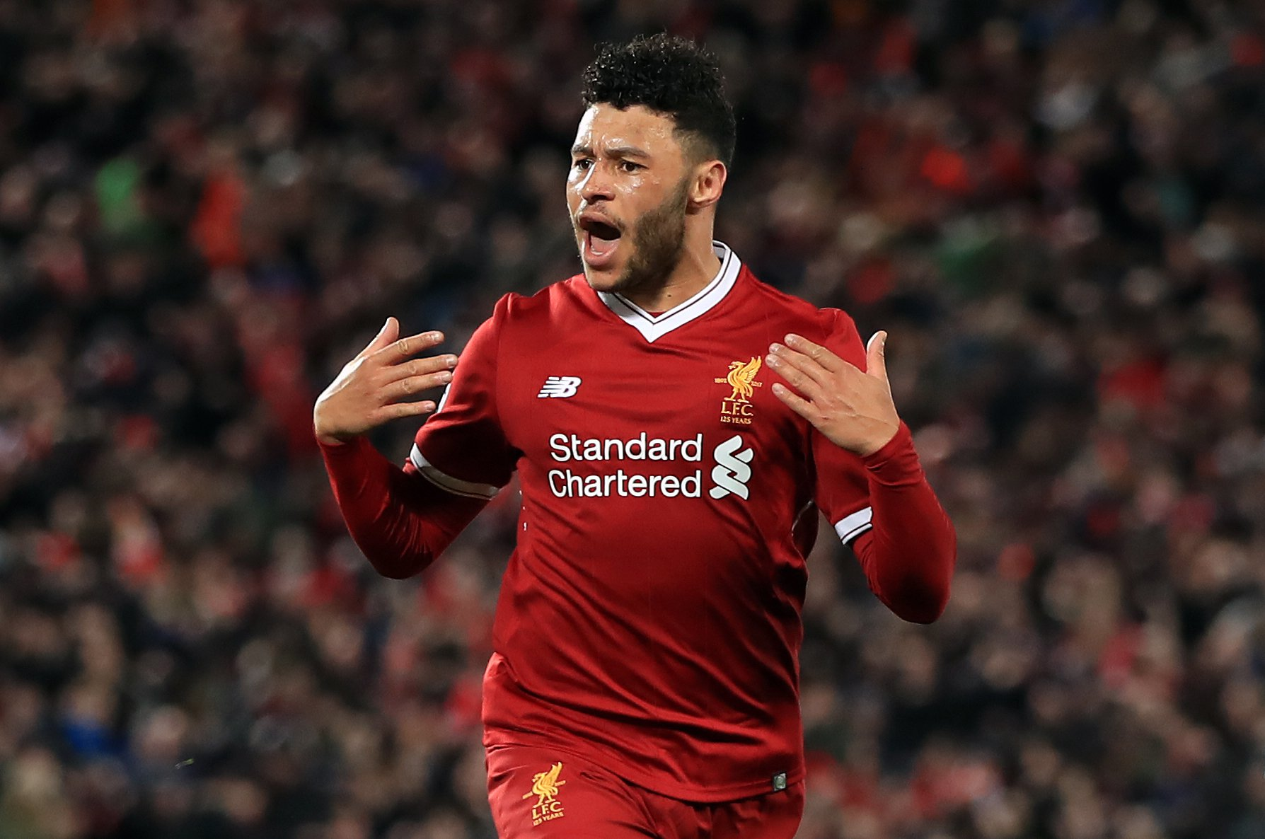 Liverpool's Alex Oxlade-Chamberlain celebrates scoring his side's second goal of the game during the UEFA Champions League quarter final, first leg match at Anfield, Liverpool. PRESS ASSOCIATION Photo. Picture date: Wednesday April 4, 2018. See PA story SOCCER Liverpool. Photo credit should read: Peter Byrne/PA Wire