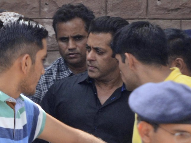 "Bollywood star Salman Khan, center, leaves a court in Jodhpur, Rajasthan state, India, Thursday, April 5, 2018. Khan was convicted Thursday of poaching rare deer in a wildlife preserve two decades ago and sentenced to five years in prison, with the trial judge describing him as a ""habitual offender."" (AP Photo/Sunil Verma)"