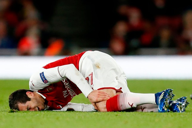 Arsenal's Armenian midfielder Henrikh Mkhitaryan picks up an injury during the UEFA Europa League first leg quarter-final football match between Arsenal and CSKA Moscow at the Emirates Stadium in London on April 5, 2018. / AFP PHOTO / IKIMAGES / Ian KINGTONIAN KINGTON/AFP/Getty Images