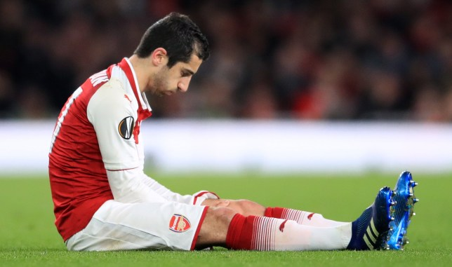 Arsenal's Henrikh Mkhitaryan lies dejected with an injury before being substituted during the UEFA Europa League quarter final, first leg match at the Emirates Stadium, London. PRESS ASSOCIATION Photo. Picture date: Thursday April 5, 2018. See PA story SOCCER Arsenal. Photo credit should read: Adam Davy/PA Wire