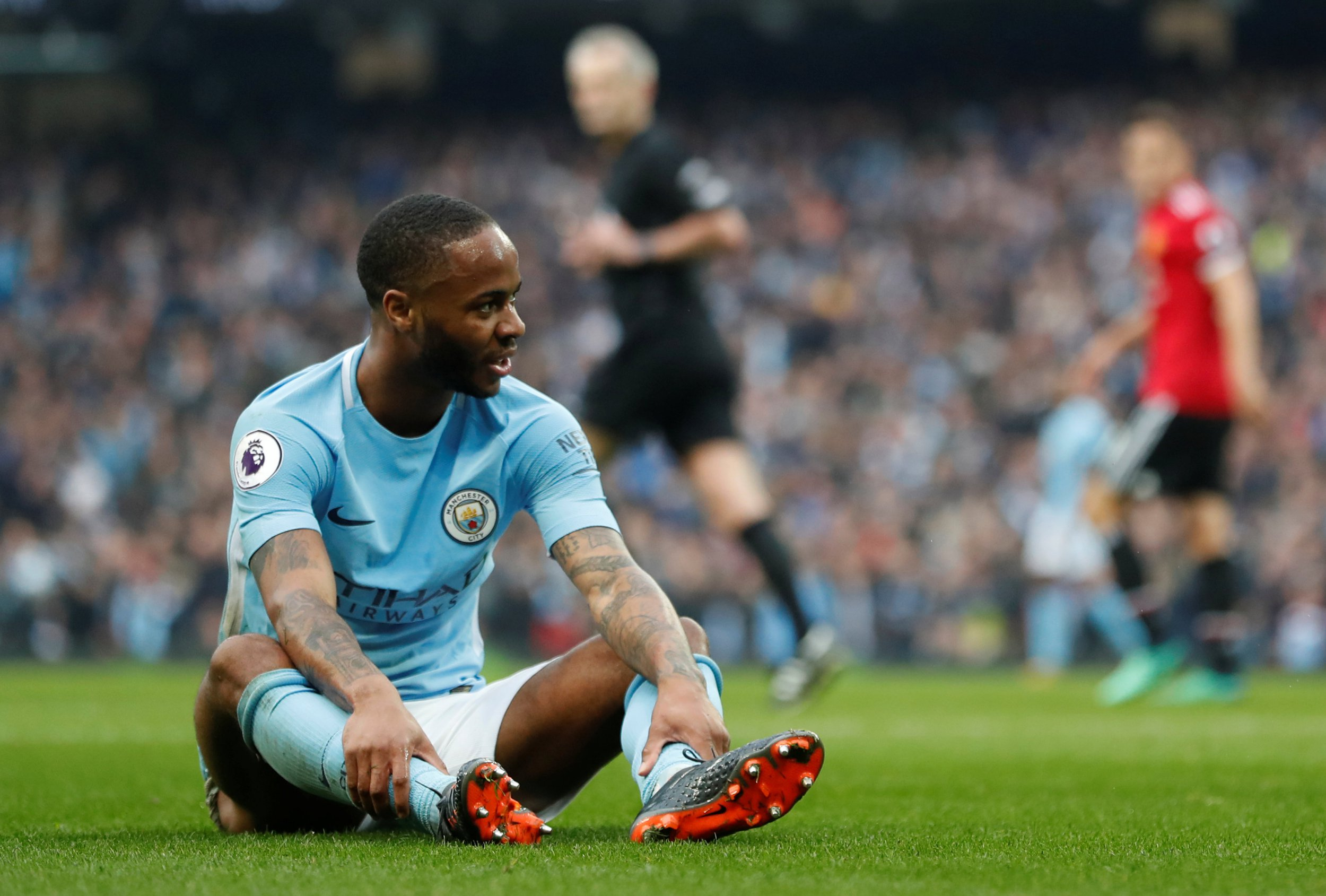"""Soccer Football - Premier League - Manchester City vs Manchester United - Etihad Stadium, Manchester, Britain - April 7, 2018 Manchester City's Raheem Sterling reacts after missing a chance to score REUTERS/Russell Cheyne EDITORIAL USE ONLY. No use with unauthorized audio, video, data, fixture lists, club/league logos or """"live"""" services. Online in-match use limited to 75 images, no video emulation. No use in betting, games or single club/league/player publications. Please contact your account representative for further details."""