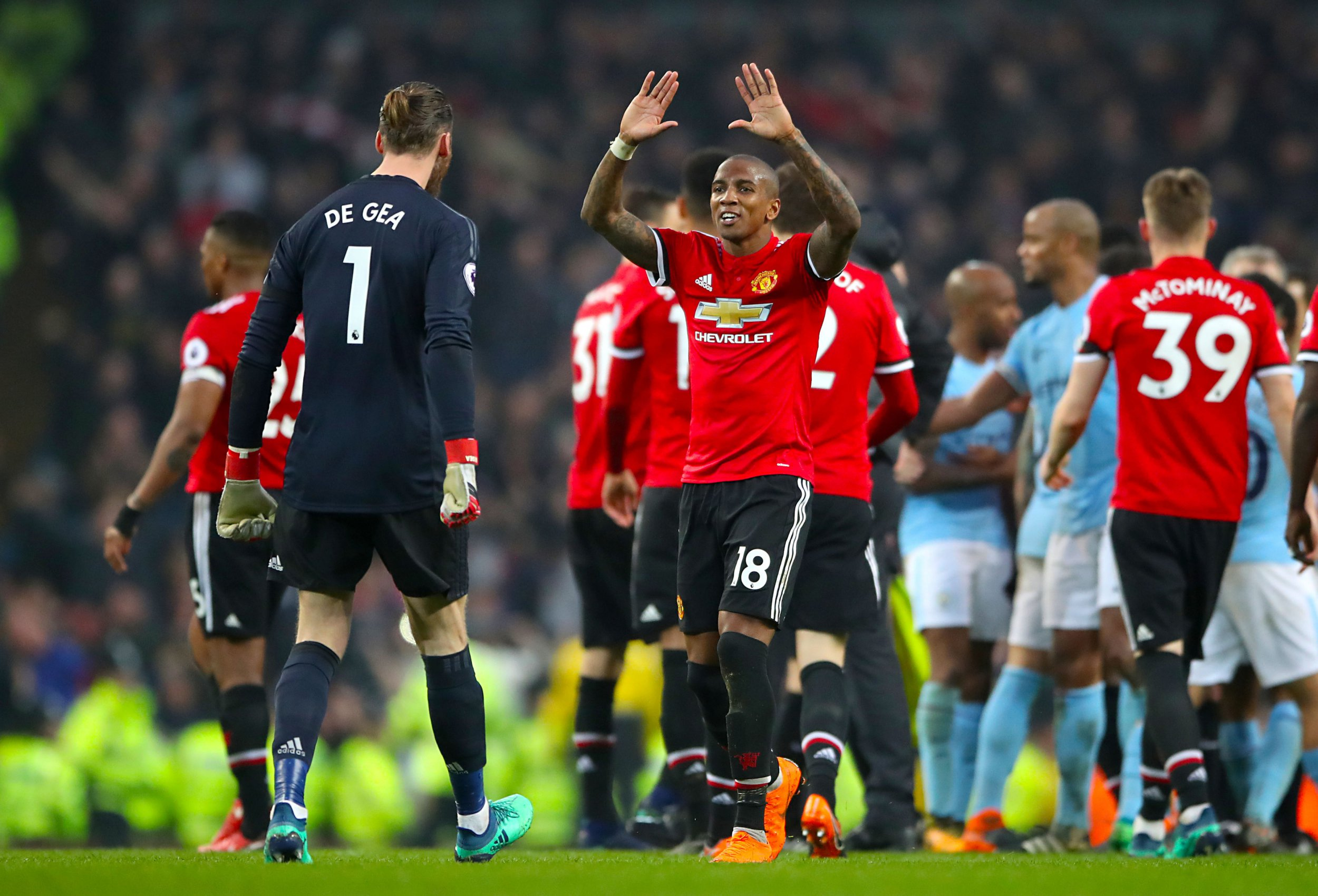 """Manchester United goalkeeper David De Gea (left) and Manchester United's Ashley Young celebrate after the final whistle of the Premier League match at the Etihad Stadium, Manchester. PRESS ASSOCIATION Photo. Picture date: Saturday April 7, 2018. See PA story SOCCER Man City. Photo credit should read: Nick Potts/PA Wire. RESTRICTIONS: EDITORIAL USE ONLY No use with unauthorised audio, video, data, fixture lists, club/league logos or """"live"""" services. Online in-match use limited to 75 images, no video emulation. No use in betting, games or single club/league/player publications."""