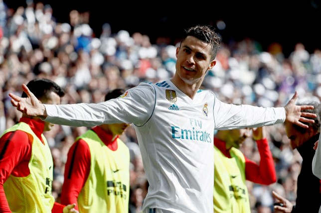 epa06655255 Real Madrid's winger Cristiano Ronaldo celebrates after scoring 1-0 during the classic derby between Real Madrid and Atletico de Madrid at Santiago Bernabeu stadium in Madrid, Spain, 08 April 2018. EPA/Mariscal