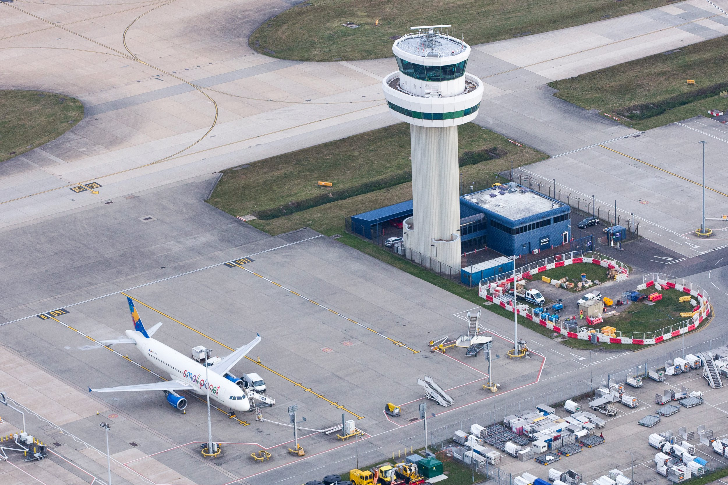 The control tower stands at London Gatwick airport in this aerial view taken over Crawley, U.K., on Monday, Oct. 24, 2016. The U.K. government will decide next week whether to expand London's main airport, Heathrow, or its rival Gatwick putting an end to decades of prevarication over what has become one of the most contentious issues in British politics. Photographer: Jason Alden/Bloomberg via Getty Images