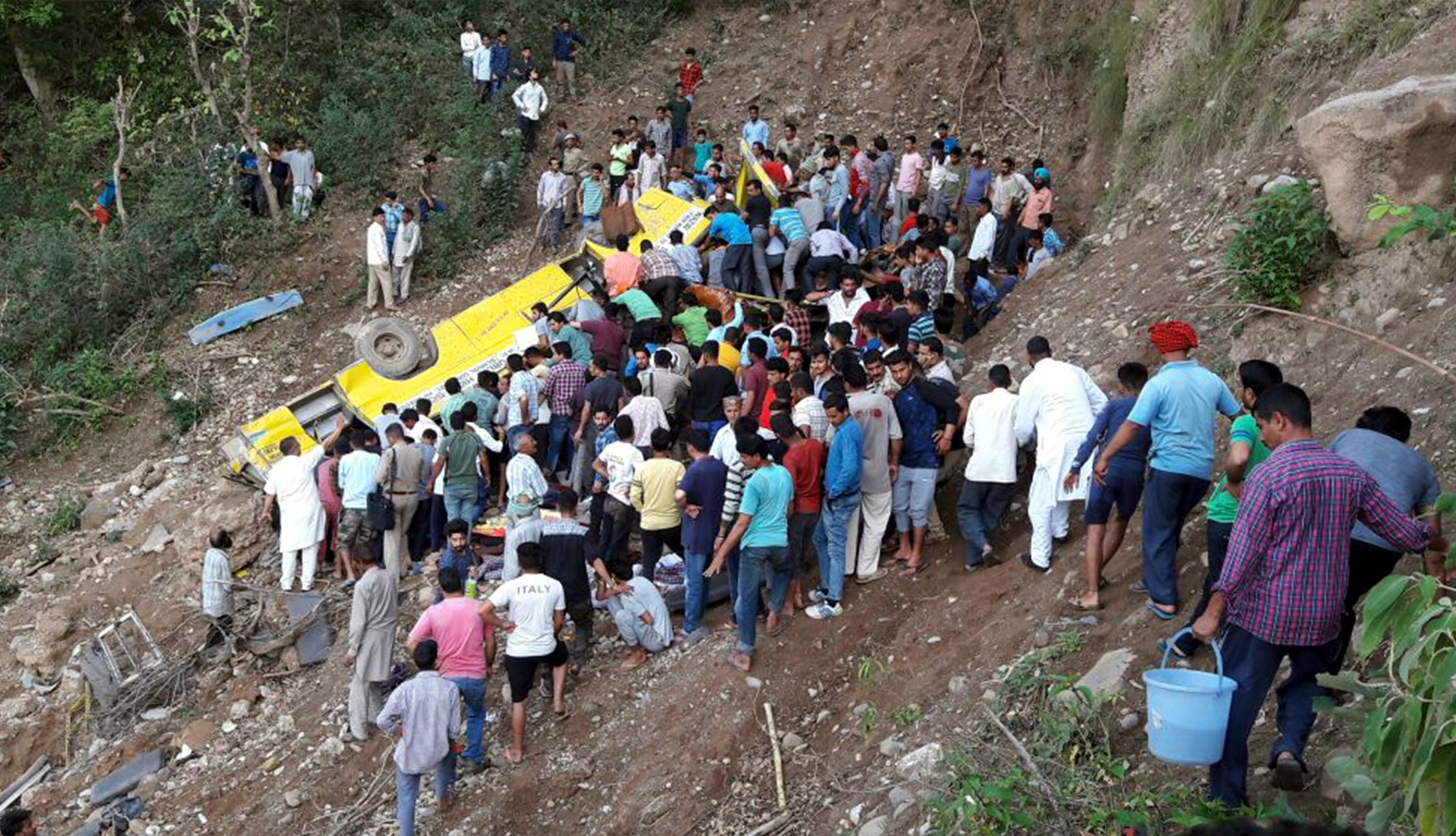 (180410) -- HIMACHAL PRADESH, April 10, 2018 (Xinhua) -- People gather at the site of a traffic accident in Kangra district of Himachal Pradesh, India, April 9, 2018. Around 20 school children were feared dead in India's northern state of Himachal Pradesh on Monday evening, when the school-bus they were travelling in fell into a deep gorge, a senior state government official confirmed to Xinhua. (Xinhua) (srb)