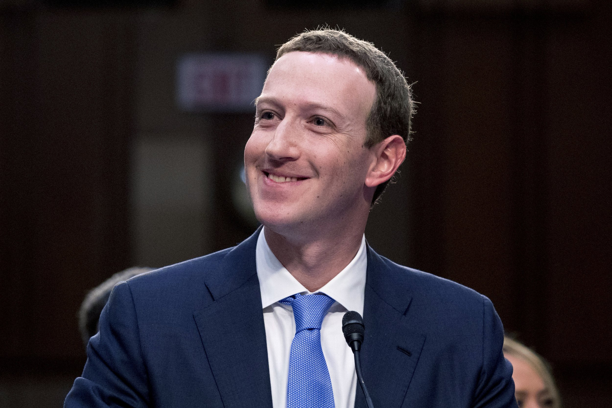 Facebook CEO Mark Zuckerberg smiles as he testifies before a joint hearing of the Commerce and Judiciary Committees on Capitol Hill in Washington, Tuesday, April 10, 2018, about the use of Facebook data to target American voters in the 2016 election. (AP Photo/Andrew Harnik)
