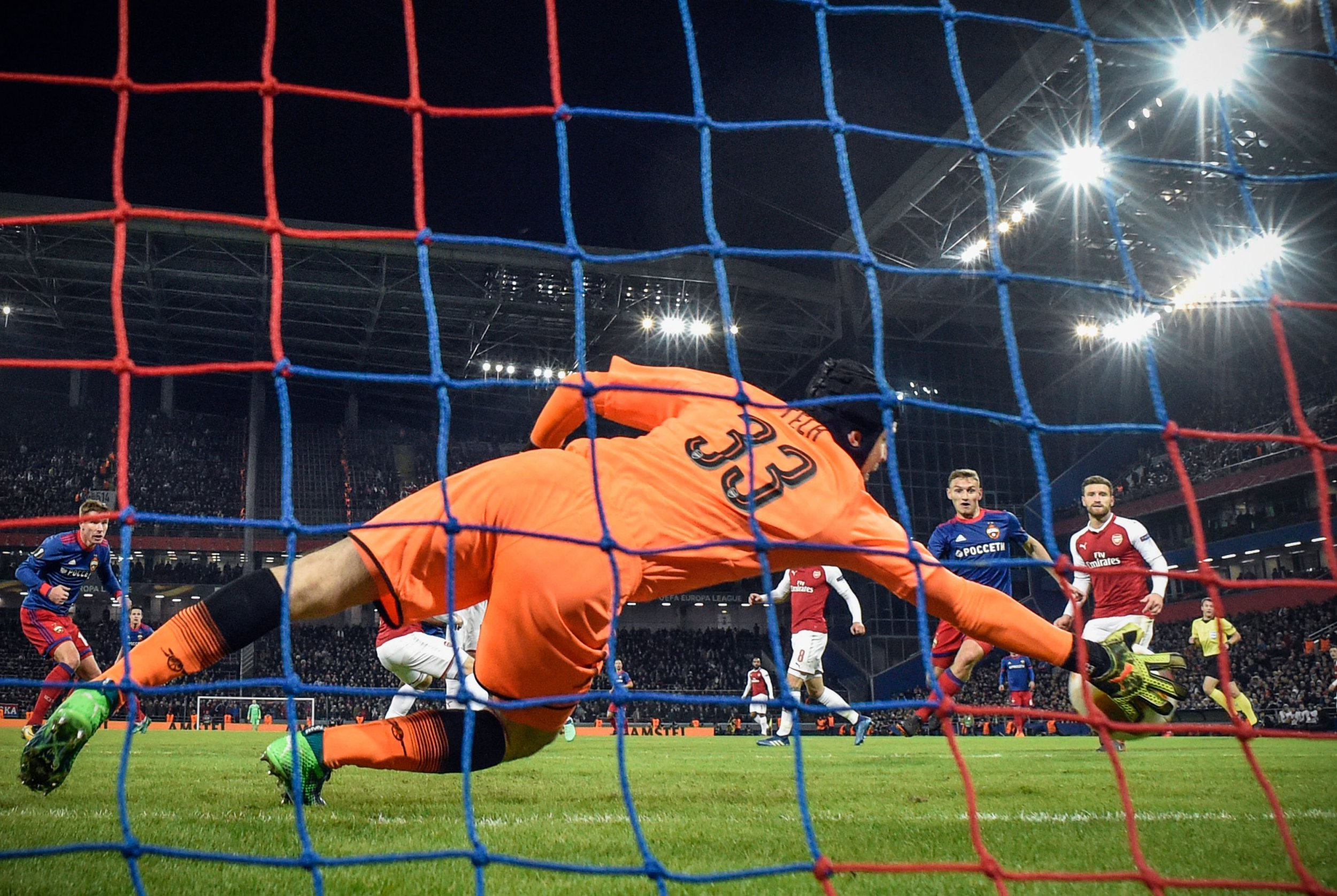 CSKA Moscow's Russian striker Fedor Chalov (2nd R) scores past Arsenal's Czech goalkeeper Petr Cech during the UEFA Europa League second leg quarter-final football match between CSKA Moscow and Arsenal at VEB Arena stadium in Moscow on April 12, 2018. / AFP PHOTO / Alexander NEMENOVALEXANDER NEMENOV/AFP/Getty Images
