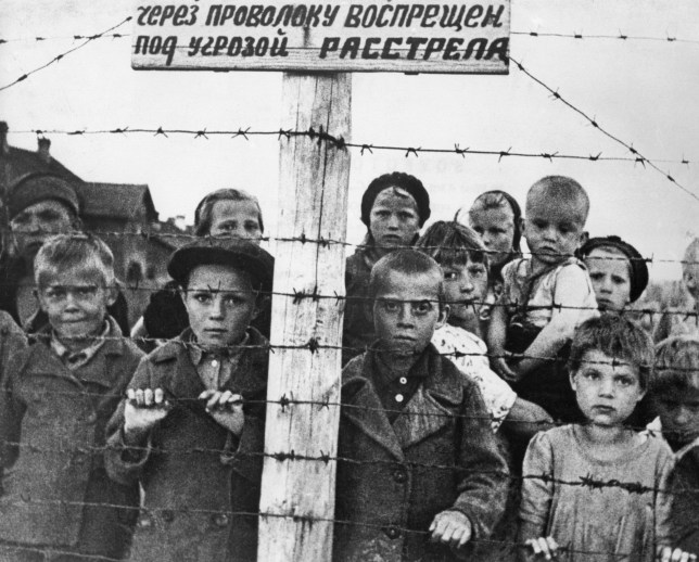 World war 2, children behind barbed wire in a german concetration camp set up in the occupied part of the karelian assr, 1941 or 1942. (Photo by: Sovfoto/UIG via Getty Images)