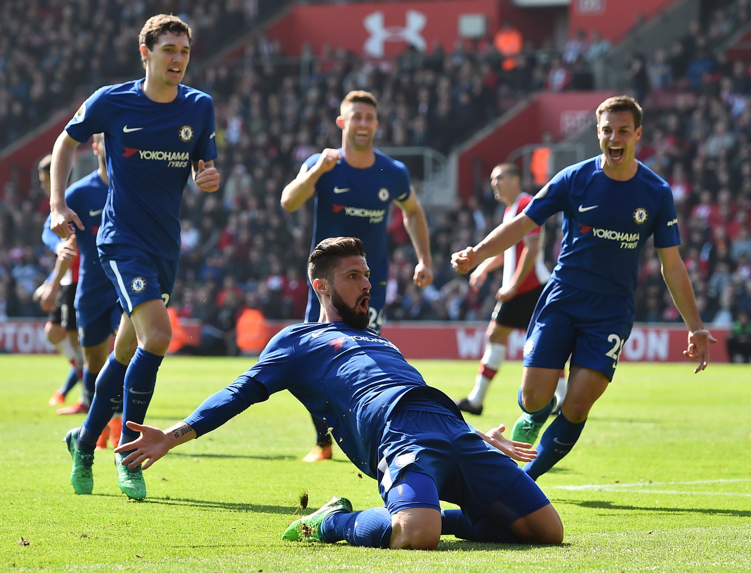 Chelsea's French attacker Olivier Giroud (C) celebrates scoring their third goal during the English Premier League football match between Southampton and Chelsea at St Mary's Stadium in Southampton, southern England on April 14, 2018. / AFP PHOTO / Glyn KIRK / RESTRICTED TO EDITORIAL USE. No use with unauthorized audio, video, data, fixture lists, club/league logos or 'live' services. Online in-match use limited to 75 images, no video emulation. No use in betting, games or single club/league/player publications. / GLYN KIRK/AFP/Getty Images