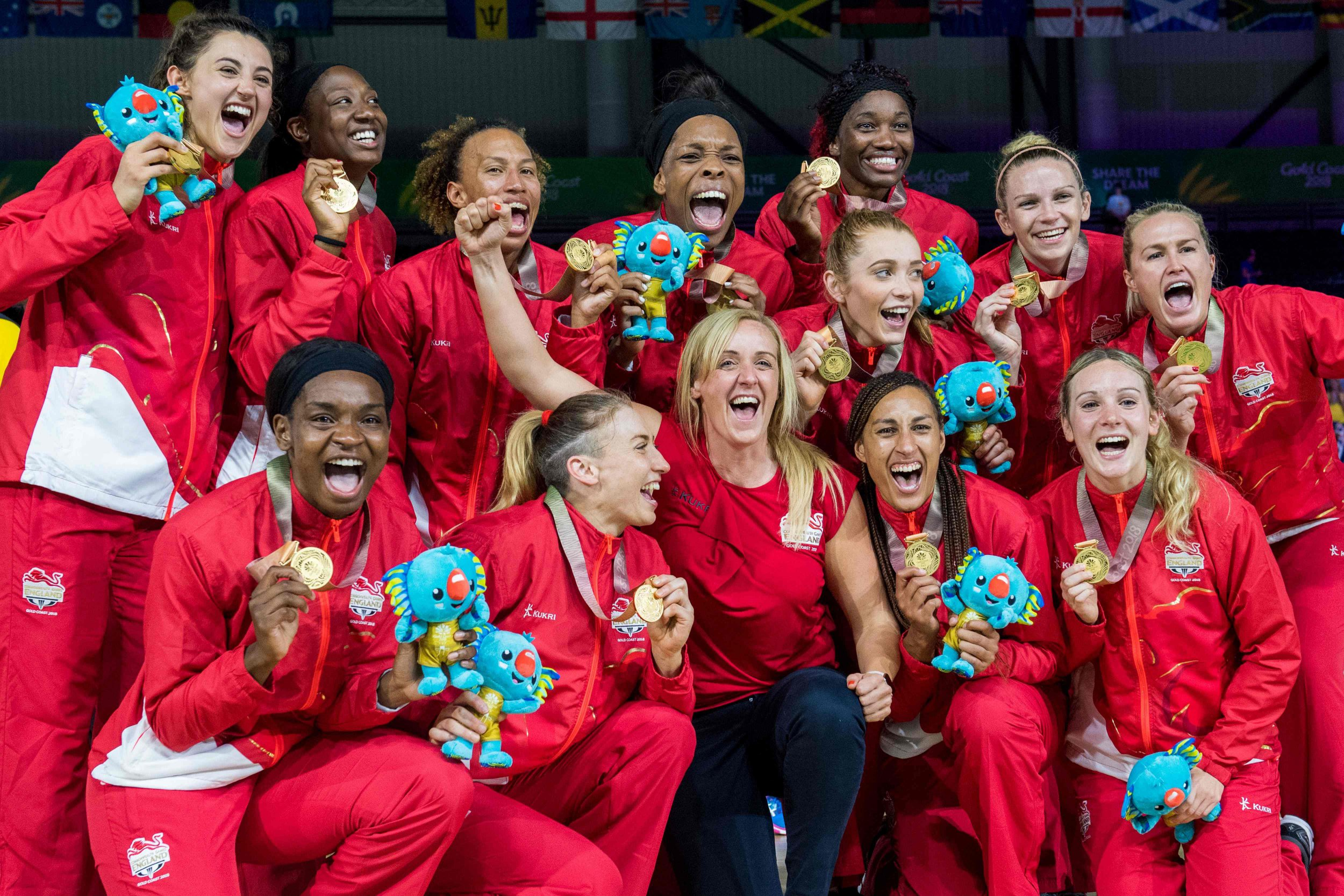 The England team poses with their gold medals after beating Australia in the women's netball gold medal match during the 2018 Gold Coast Commonwealth at the Coomera Indoor Sports Centre on the Gold Coast on April 15, 2018. / AFP PHOTO / Fran??ois-Xavier MARITFRANCOIS-XAVIER MARIT/AFP/Getty Images