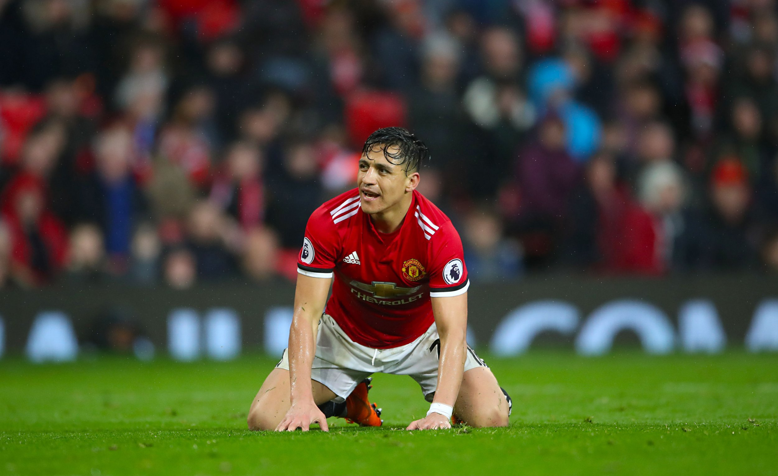 """Manchester United's Alexis Sanchez on the ground after a challenge during the Premier League match at Old Trafford, Manchester. PRESS ASSOCIATION Photo. Picture date: Sunday April 15, 2018. See PA story SOCCER Man Utd. Photo credit should read: Nick Potts/PA Wire. RESTRICTIONS: EDITORIAL USE ONLY No use with unauthorised audio, video, data, fixture lists, club/league logos or """"live"""" services. Online in-match use limited to 75 images, no video emulation. No use in betting, games or single club/league/player publications."""