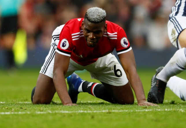 """Soccer Football - Premier League - Manchester United vs West Bromwich Albion - Old Trafford, Manchester, Britain - April 15, 2018 Manchester United's Paul Pogba looks dejected Action Images via Reuters/Jason Cairnduff EDITORIAL USE ONLY. No use with unauthorized audio, video, data, fixture lists, club/league logos or """"live"""" services. Online in-match use limited to 75 images, no video emulation. No use in betting, games or single club/league/player publications. Please contact your account representative for further details."""