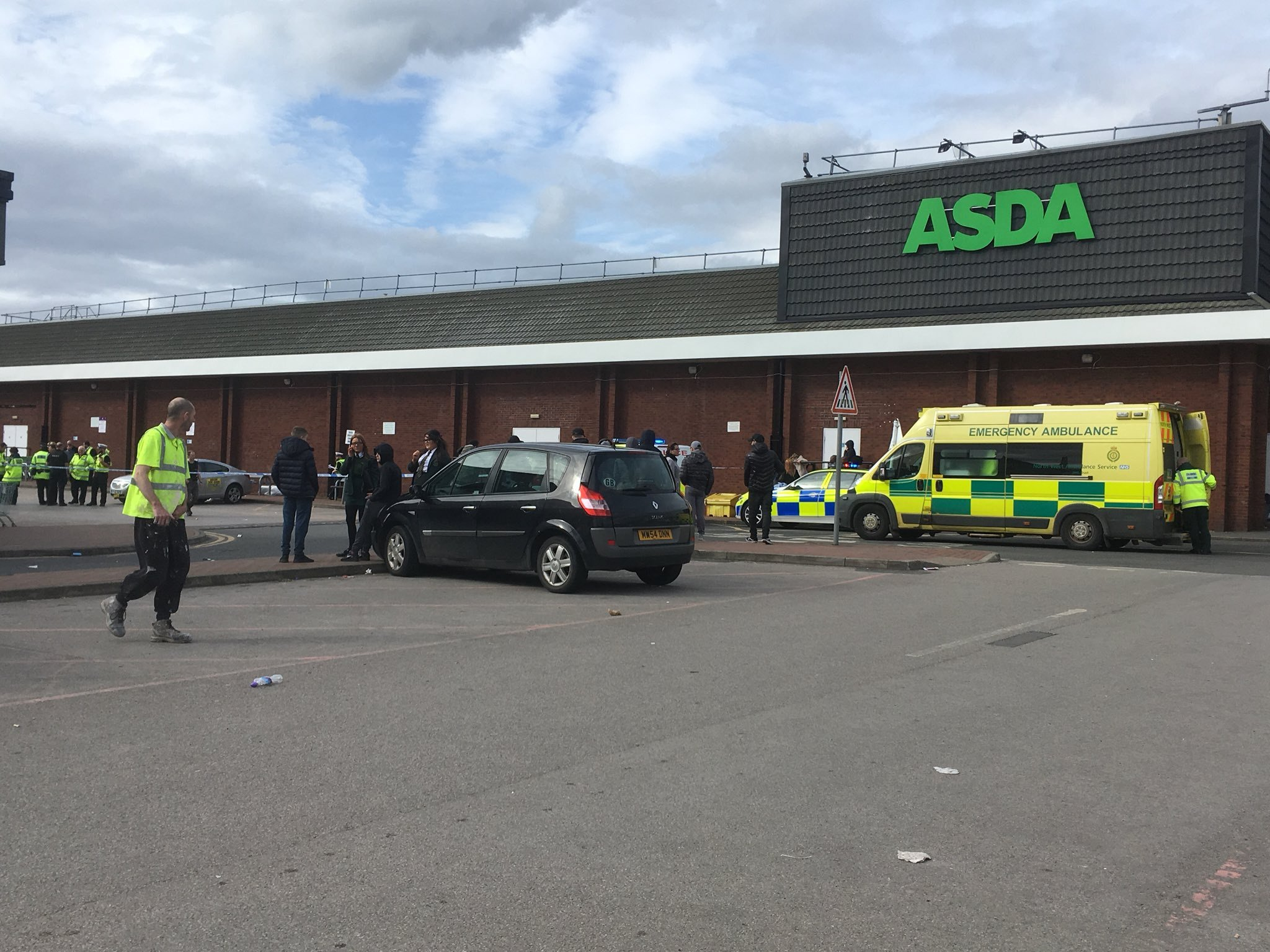 Six people have been injured after a car was driven into a crowd of people at a shopping centre in north Manchester. Emergency services were called to the Asda at Harpurhey shopping centre just before 3.30pm today (Monday). Caption: Emergency services at scene