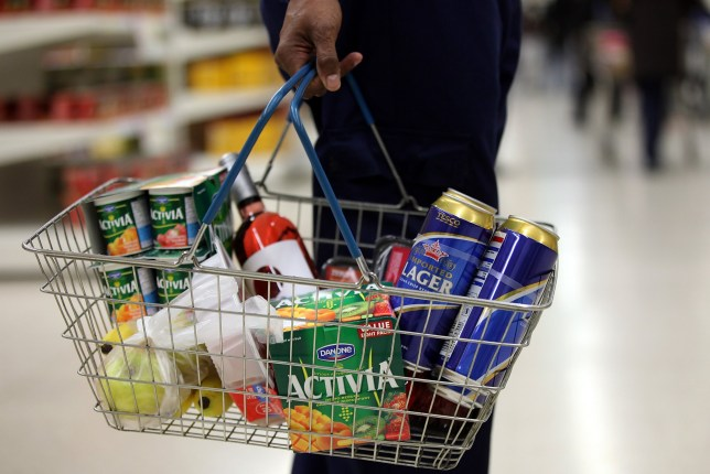 A customer holds a shopping basket of goods at a Tesco supermarket in London, U.K., on Monday, Oct. 4, 2010. Tesco Plc half-year results, due tomorrow, are likely to reflect a tougher period for the UK's number one grocer. Photographer: Simon Dawson/Bloomberg via Getty Images