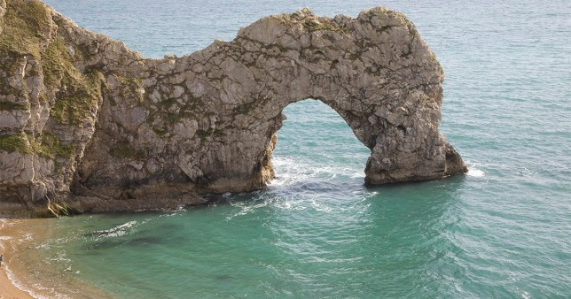Famous natural coastal arch of Durdle Door on the Jurassic coast, Dorset, England (Photo by: Geography Photos/Universal Images Group via Getty Images)