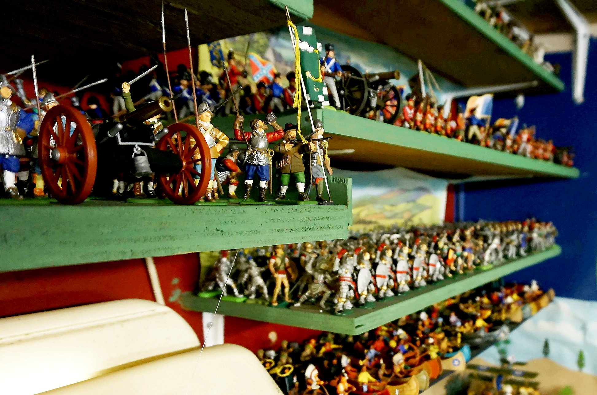 An epic collection of around 250,000 toy soldiers ? collected in a Bristol garage over a lifetime by an enthusiast ? is to go under the hammer. See SWNS story SWSOLDIERS; The collection which filled a double garage in Brislington belonged to a 55 year-old Carmelo Mazzotta who sadly passed away after a battle with leukaemia. Mr Mazzotta had been collecting the toy soldiers since he was eight years old. The collection, some of which was displayed in their individual regiments in the garage, is understood to be the biggest in the world ever to go to auction. The tiny figures are made out of a variety of materials, including lead, metal and plastic. Alongside the soldiers, the collection also features a variety of accessories from miniature forts and weapons to trees and military vehicles. Most of the soldiers stand between one inch and two inches tall, although some of the figures are larger.