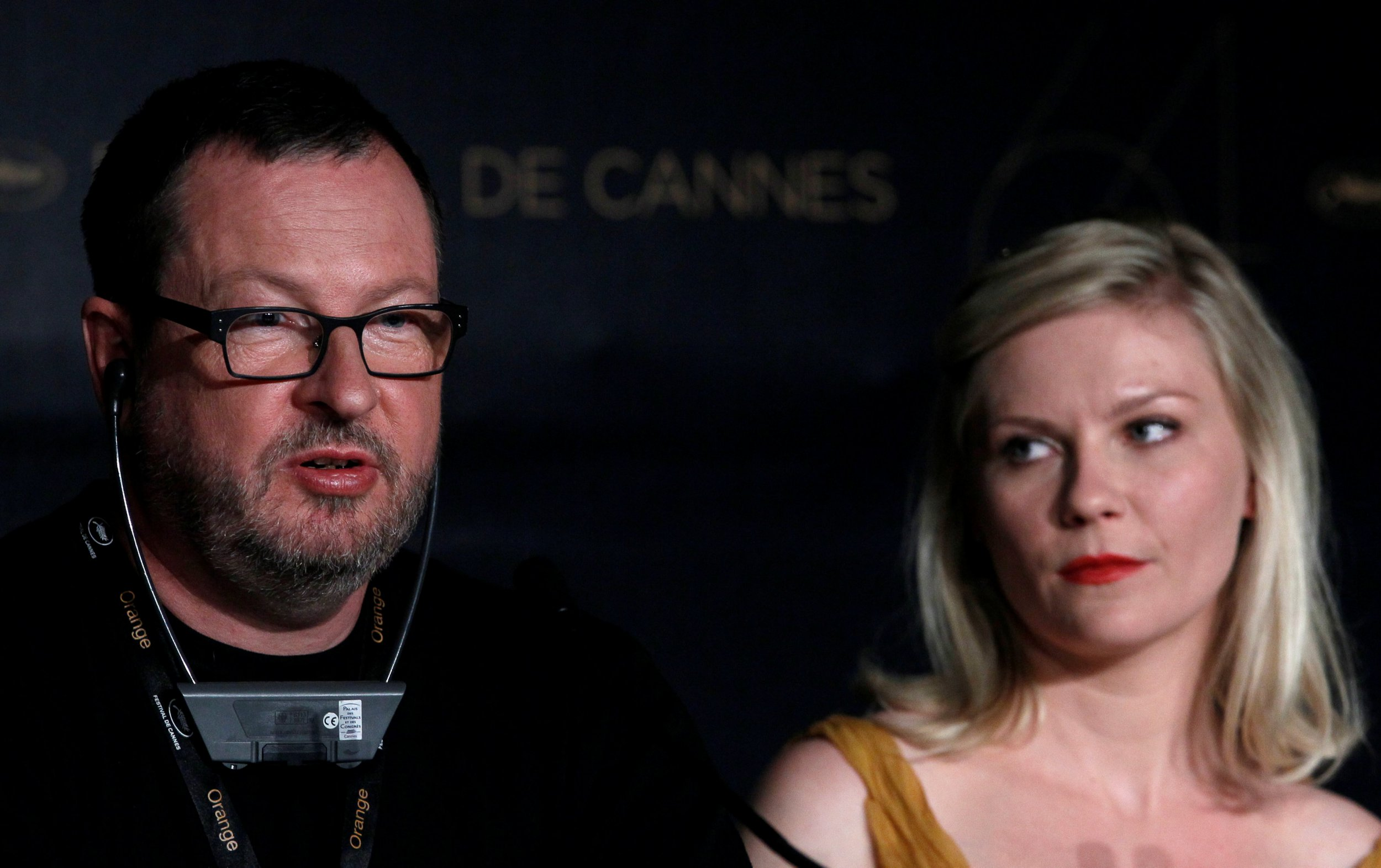 "FILE PHOTO: Director Lars Von Trier (L) and cast member Kirsten Dunst attend a news conference for the film ""Melancholia"", in competition at the 64th Cannes Film Festival, May 18, 2011. REUTERS/Yves Herman/File Photo"