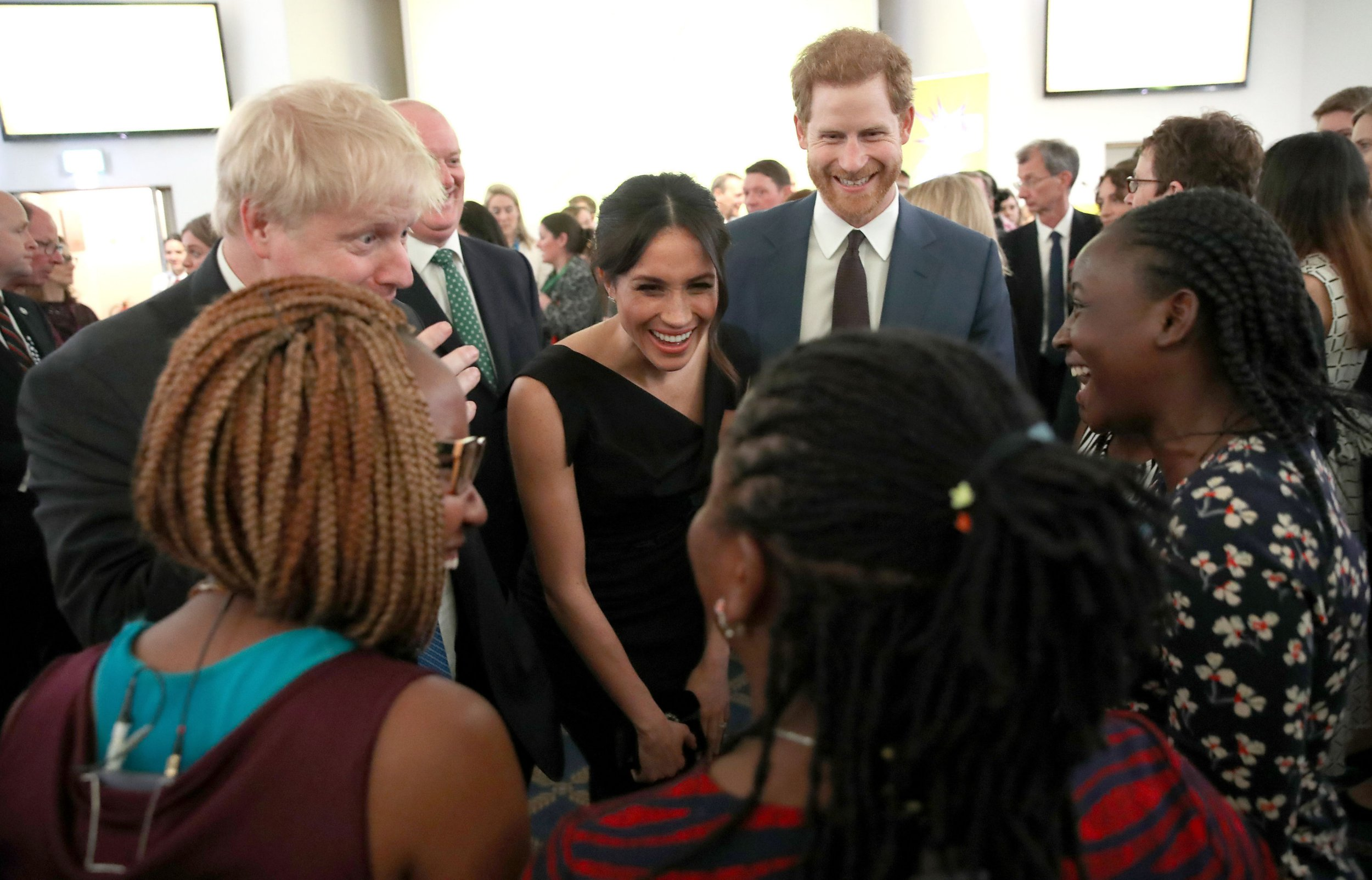 Foreign Secretary Boris Johnson, Prince Harry and Meghan Markle speak to guests at a women's empowerment reception hosted by Mr Johnson at the Royal Aeronautical Society in London during the Commonwealth Heads of Government Meeting. PRESS ASSOCIATION Photo. Picture date: Thursday April 19, 2018. See PA story ROYAL Commonwealth. Photo credit should read: Chris Jackson/PA Wire