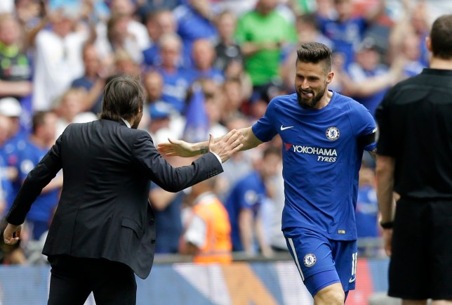 Chelsea's Olivier Giroud celebrates with Chelsea head coach Antonio Conte, left, after scoring the opening goal during the English FA Cup semifinal soccer match between Chelsea and Southampton at Wembley stadium in London, Sunday, April 22, 2018. (AP Photo/Alastair Grant)