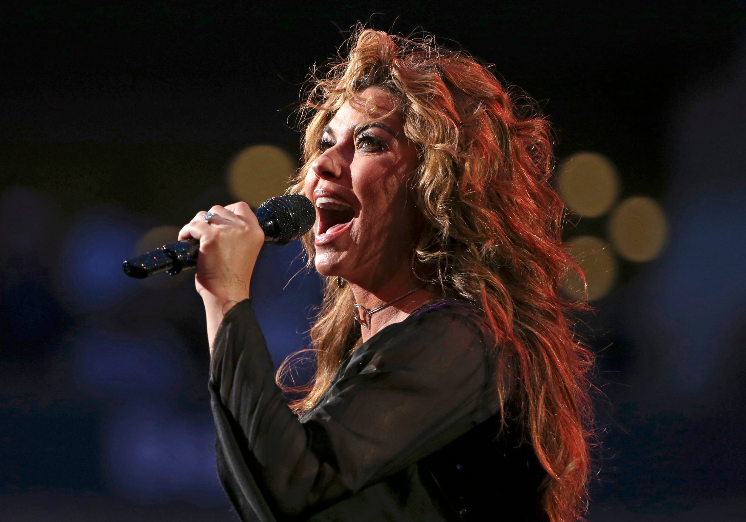 "FILE - In this Aug. 28, 2017, file photo, Shania Twain performs during opening ceremonies for the U.S. Open tennis tournament in New York. Twain has apologized for saying if she were American she would have voted for Donald Trump for president, even though he's offensive. She made the comments in an interview with The Guardian that was published over the weekend. She told the British newspaper ""Do you want straight or polite? ??? I would have voted for a feeling that is transparent."" (AP Photo/Kathy Willens, File)"