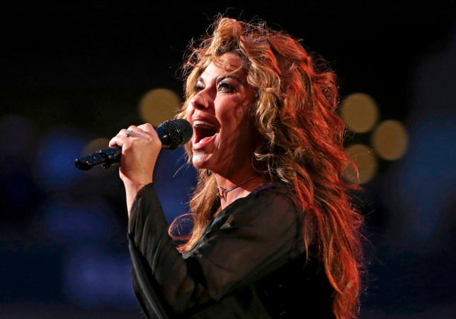 """FILE - In this Aug. 28, 2017, file photo, Shania Twain performs during opening ceremonies for the U.S. Open tennis tournament in New York. Twain has apologized for saying if she were American she would have voted for Donald Trump for president, even though he's offensive. She made the comments in an interview with The Guardian that was published over the weekend. She told the British newspaper """"Do you want straight or polite? ??? I would have voted for a feeling that is transparent."""" (AP Photo/Kathy Willens, File)"""