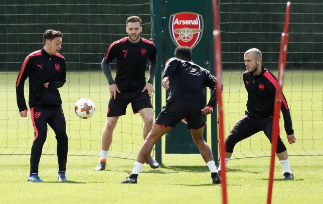 Soccer Football - Europa League - Arsenal Training - Arsenal Training Centre, St Albans, Britain - April 25, 2018 Arsenal's Mesut Ozil, Calum Chambers and Jack Wilshere during training Action Images via Reuters/Andrew Couldridge