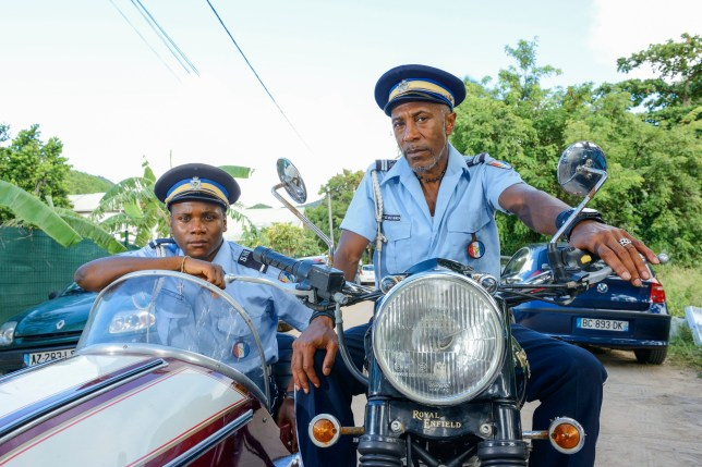 Programme Name: Death in Paradise - TX: n/a - Episode: n/a (No. Generics) - Picture Shows: (L-R) JP (TOBI BAKARE), Dwayne (DANNY JOHN-JULES) - (C) Red Planet Pictures - Photographer: Denis Guyenon