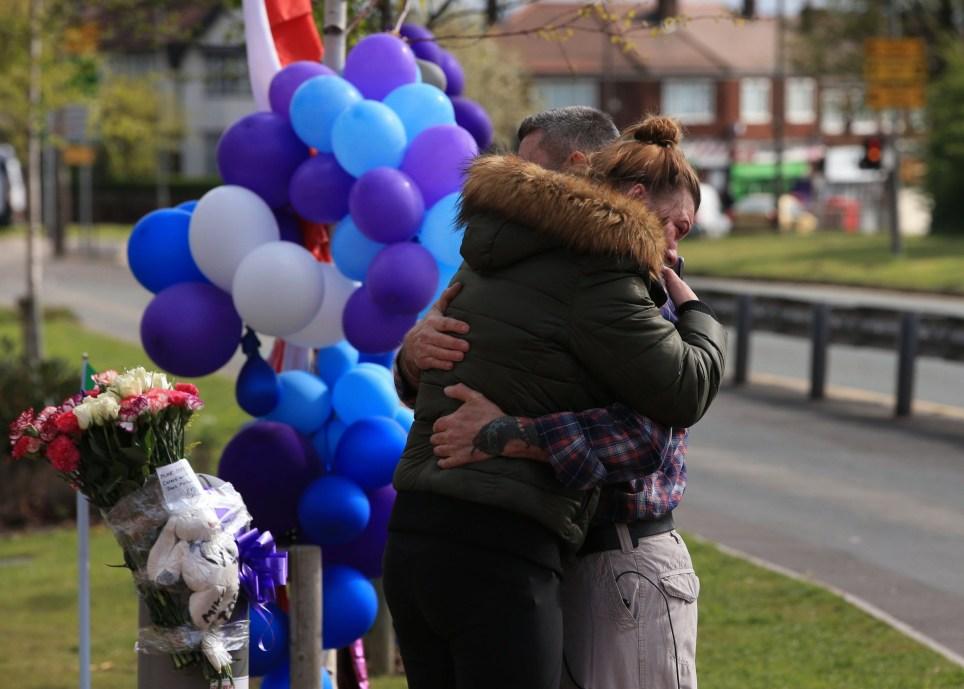 Floral tributes at Alder Hey as hospital address death