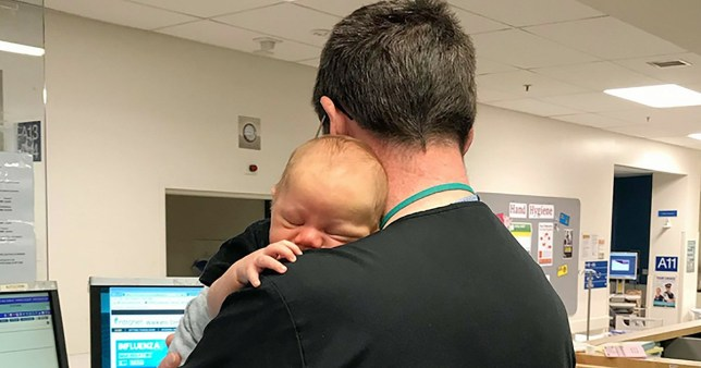 Doctor runs entire A&E while cuddling baby Dr Muir Wallace Picture: Waikato Hospital METROGRAB TAKEN FROM OPEN FACEBOOK PAGE https://www.facebook.com/WaikatoHospital/photos/a.346915758692772.94717.168646373186379/1848315391886127/?type=3&theater
