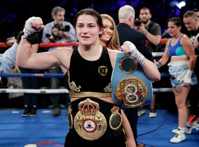 Ireland's Katie Taylor poses for photographs after winning a women's lightweight championship boxing match against Argentina's Victoria Noelia Bustos, back right, Saturday, April 28, 2018, in New York. Taylor won the fight. (AP Photo/Frank Franklin II)