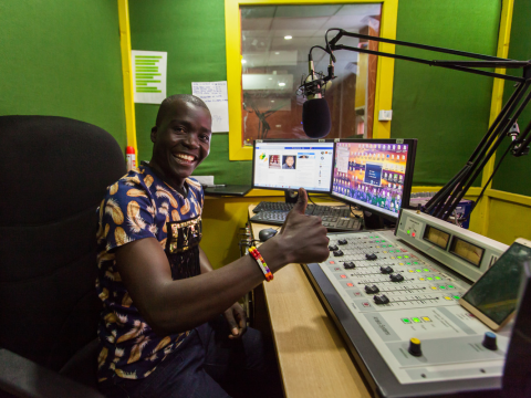 Meet the DJ educating Kenyan slum residents on their rights over the airwaves