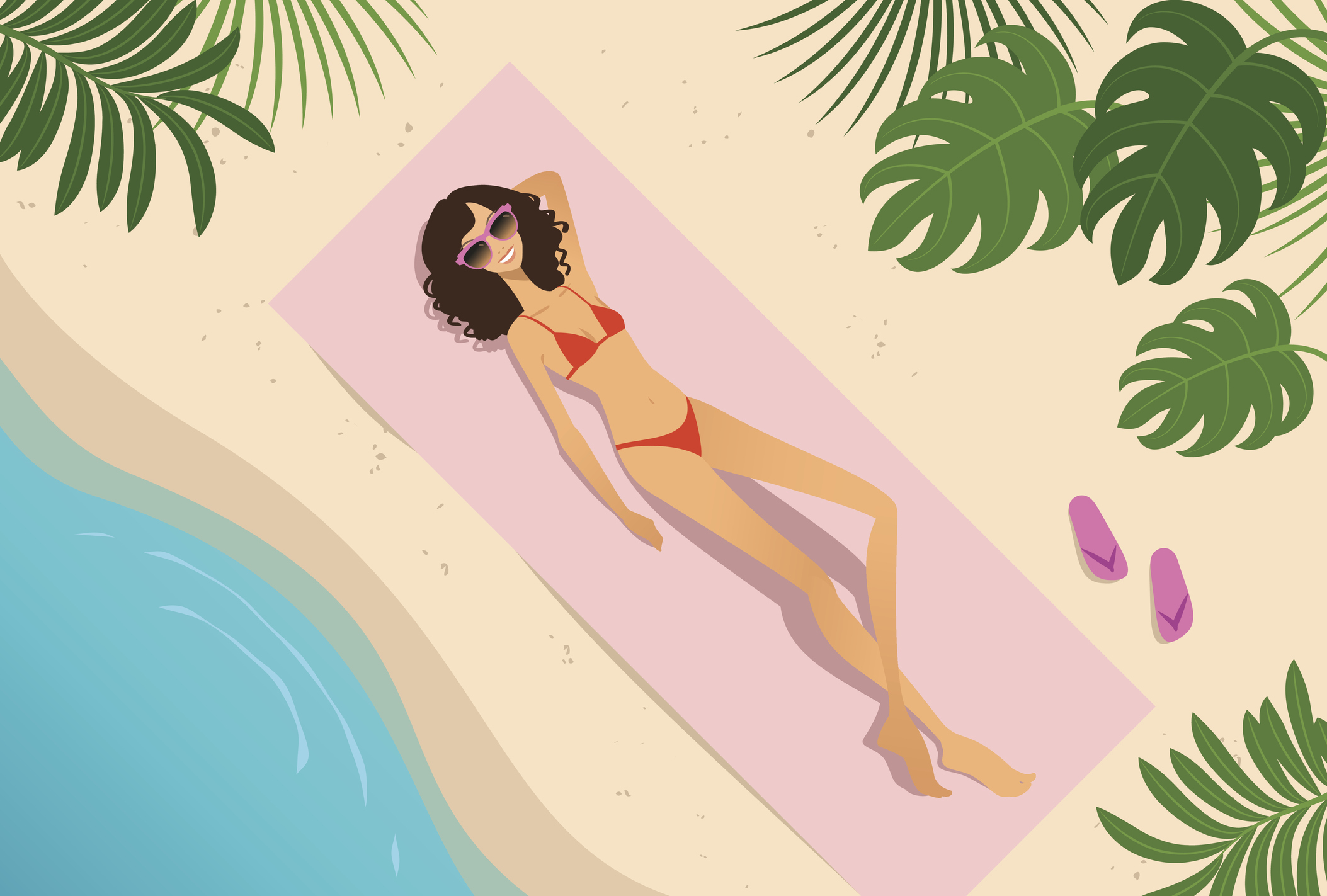 Young woman sunbathing on the beach, high angle view.